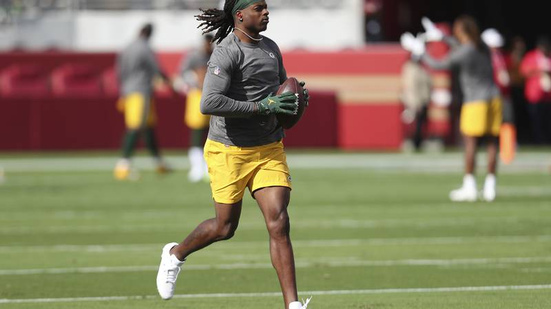 Green Bay Packers wide receiver Davante Adams warms up before an NFL football game against the...