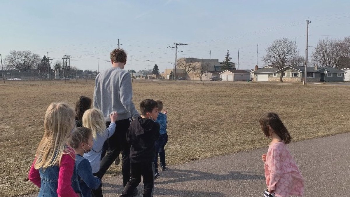 Dominic Ballweg is pictured assisting a group of young kids during his time as a teaching...
