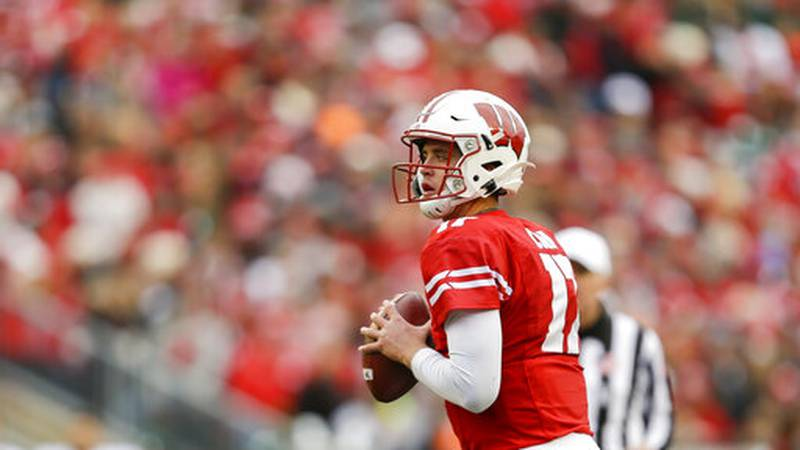 Wisconsin quarterback Jack Coan (17) during the first half of an NCAA college football game...
