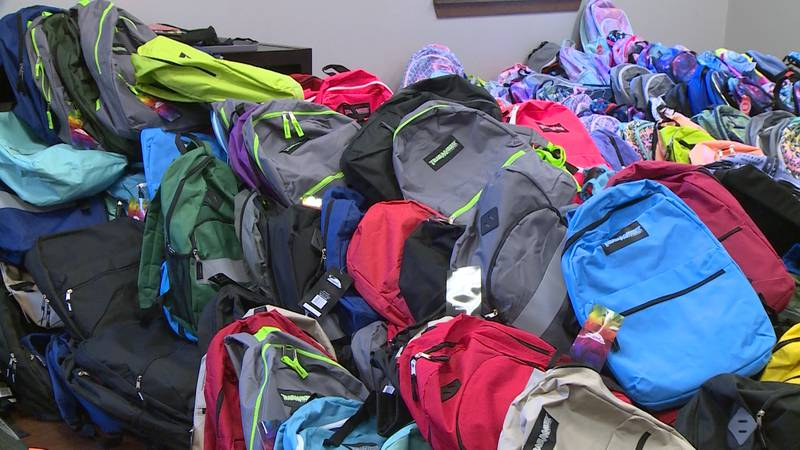 Valley Vineyard Church hands out backpacks and school supplies.