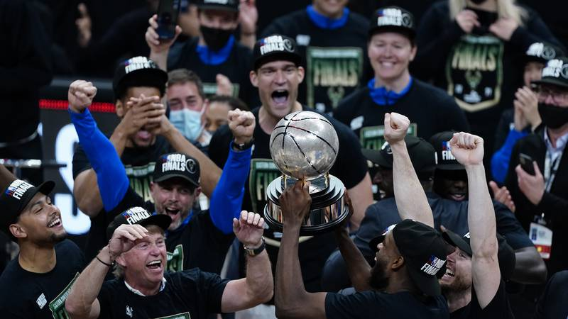 Milwaukee Bucks celebrate with the trophy after defeating the against the Atlanta Hawks in game...