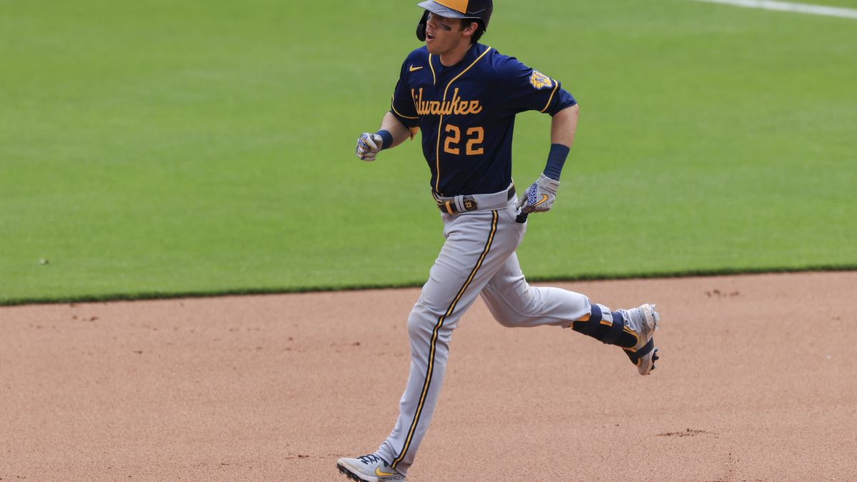 Milwaukee Brewers' Christian Yelich runs the bases after he hits a solo home run during a...