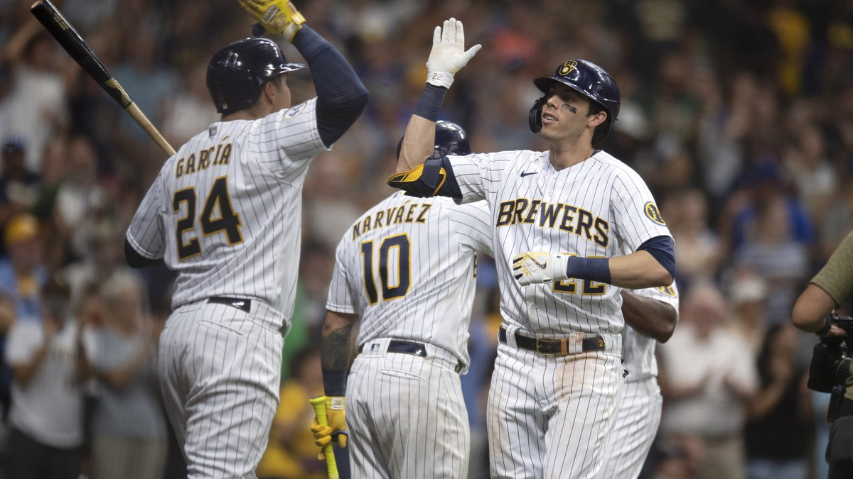 Milwaukee Brewers' Christian Yelich, right, is congratulated by Avisail Garcia after Yelich's...