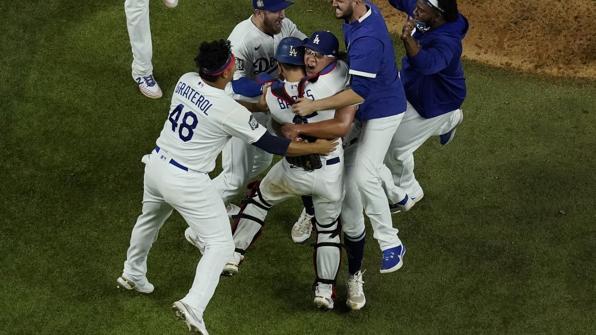 Los Angeles Dodgers celebrate after defeating the Tampa Bay Rays 3-1 to win the baseball World...