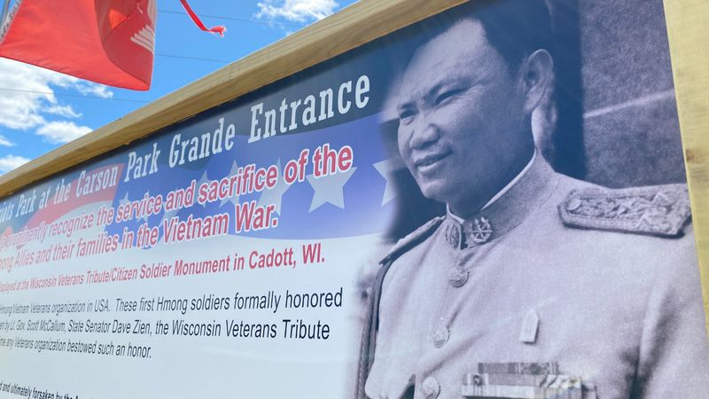 The ribbon-cutting was for signs which were put up to salute the area's Hmong population which...