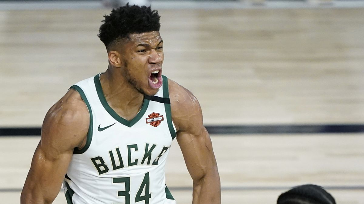 Milwaukee Bucks forward Giannis Antetokounmpo (34) reacts after he scored against the Orlando Magic during the second half of an NBA basketball first round playoff game, Thursday, Aug. 20, 2020, in Lake Buena Vista, Fla. (AP Photo/Ashley Landis, Pool)