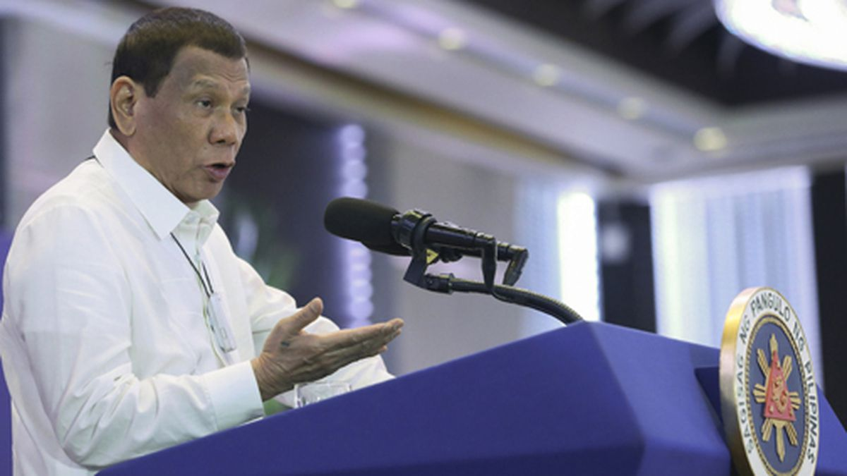 In this Monday, Feb. 10, 2020 photo provided by the Malacanang Presidential Photographers Division, Philippine President Rodrigo Duterte delivers a speech during the 11th Biennial National Convention and 22nd founding anniversary of the Chinese Filipino Business Club, Inc. in Manila, Philippines. The Philippines on Tuesday notified the United States of its intent to terminate a major security pact allowing American forces to train in the country in the most serious threat to the countries' treaty alliance under President Rodrigo Duterte. (Toto Lozano/Malacanang Presidential Photographers Division via AP)