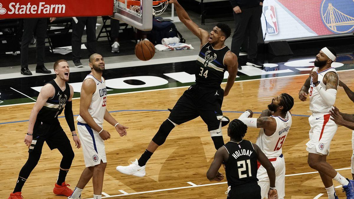 Milwaukee Bucks' Giannis Antetokounmpo dunks during the second half of an NBA basketball game...