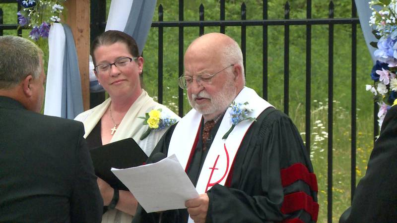 Jerry Richards performing a wedding ceremony at Azura Memory Care Eau Claire in Eau Claire, Wis.