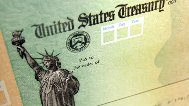 Blank stimulus checks are seen on an idle press at the Philadelphia Regional Financial Center,...