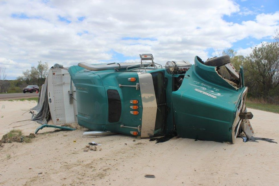 An overturned semi hauling wheat was involved in a deadly crash near Lake Wissota on Monday...
