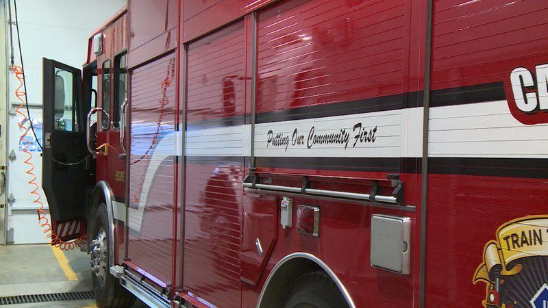 "Painted across an Altoona Fire Department fire truck, ""Putting Our Community First,"" describes..."