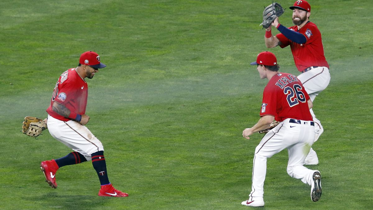 Minnesota Twins outfielders Eddie Rosario, left, Max Kepler, lower right, and Jake Cave celebrate the Twins' 7-1 win over the Milwaukee Brewers in a baseball game, Thursday, Aug. 20, 2020, in Minneapolis. (AP Photo/Jim Mone)