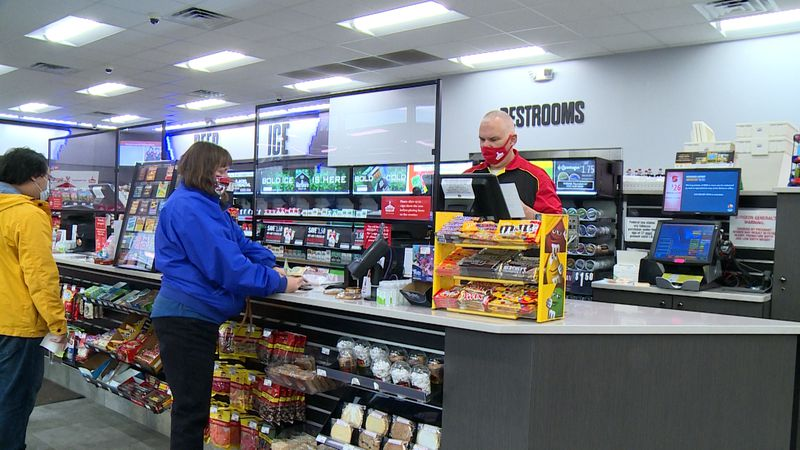People buy lottery tickets at Casey's General Store on Wednesday.