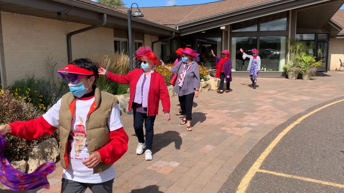 The Red Hat Society paraded around the Chippewa Manor in an effort to cheer up residents.