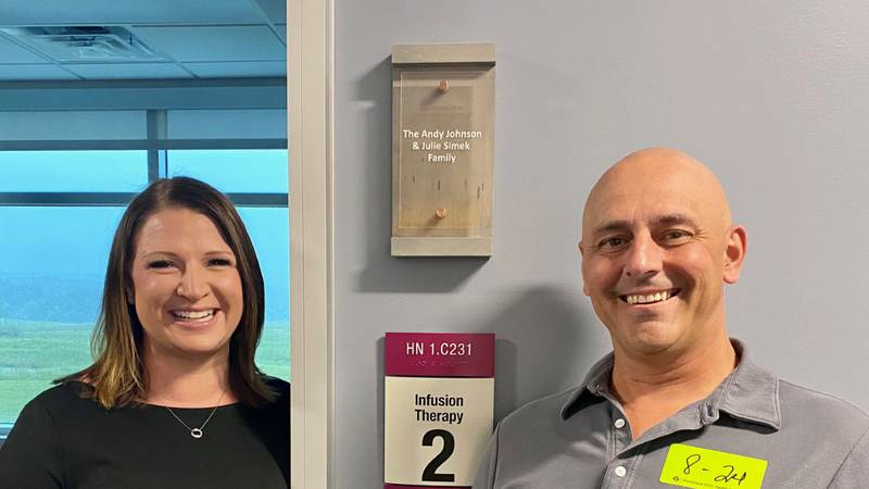 Andy Johnson and Julie Simek stand in front of their newly-donated infusion therapy suite at...