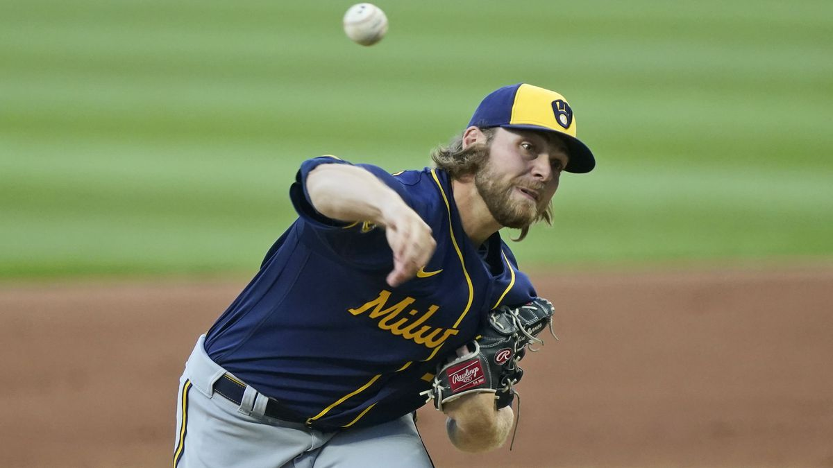 Milwaukee Brewers starting pitcher Corbin Burnes delivers in the first inning in a baseball game against the Cleveland Indians, Friday, Sept. 4, 2020, in Cleveland. (AP Photo/Tony Dejak)