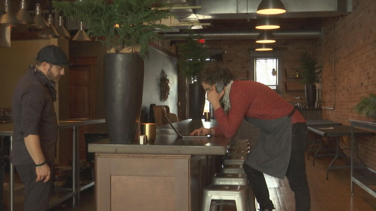 Christopher Mangless of Three Three Five in Green Bay is taking orders for meals he's...