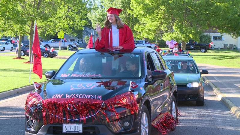 Chippewa Falls High School graduate collects diploma at Friday's drive-in ceremony.