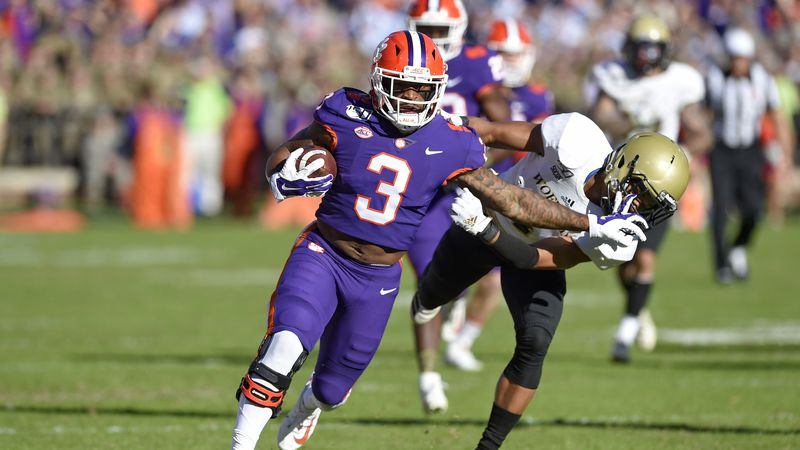 Clemson's Amari Rodgers (3) stiff arms Wofford's Keyvaun Cobb to gain a first down during the...