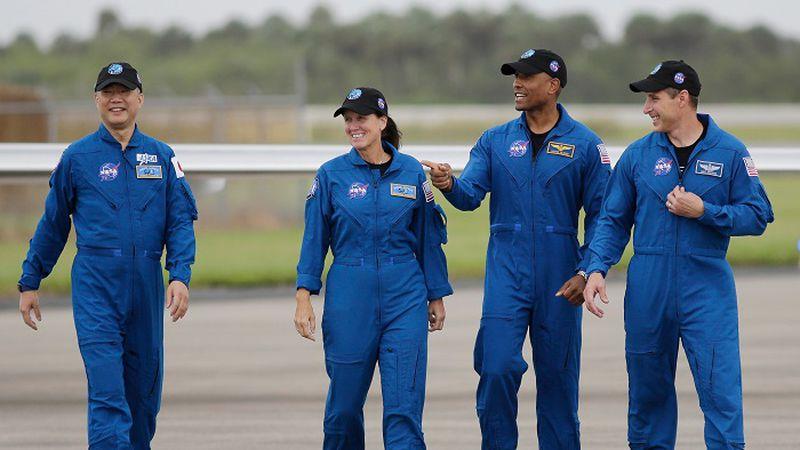 Astronaut Soichi Noguchi, of Japan, from left, NASA Astronauts Shannon Walker, Victor Glover...