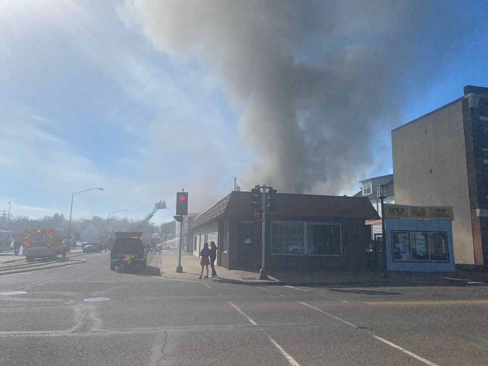 Smoke rising from a building in Chippewa Falls