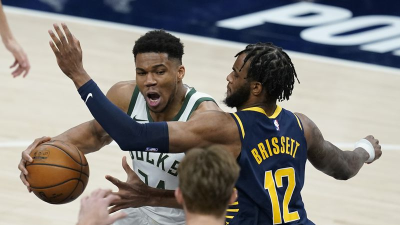 Milwaukee Bucks' Giannis Antetokounmpo (34) goes to the basket against Indiana Pacers' Oshae...