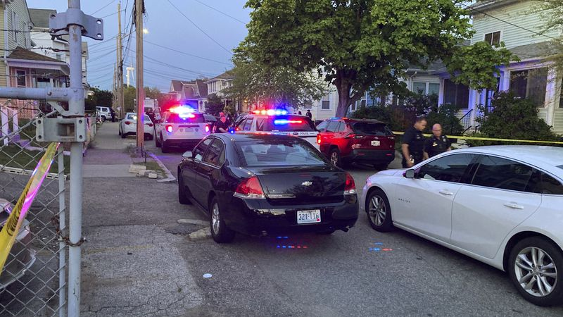 Authorities respond to the scene where multiple people were wounded in a shooting, Thursday,...