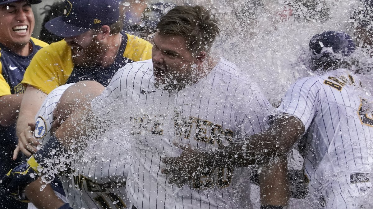 Milwaukee Brewers' Daniel Vogelbach is congratulated by teammates after hitting a walk-off...