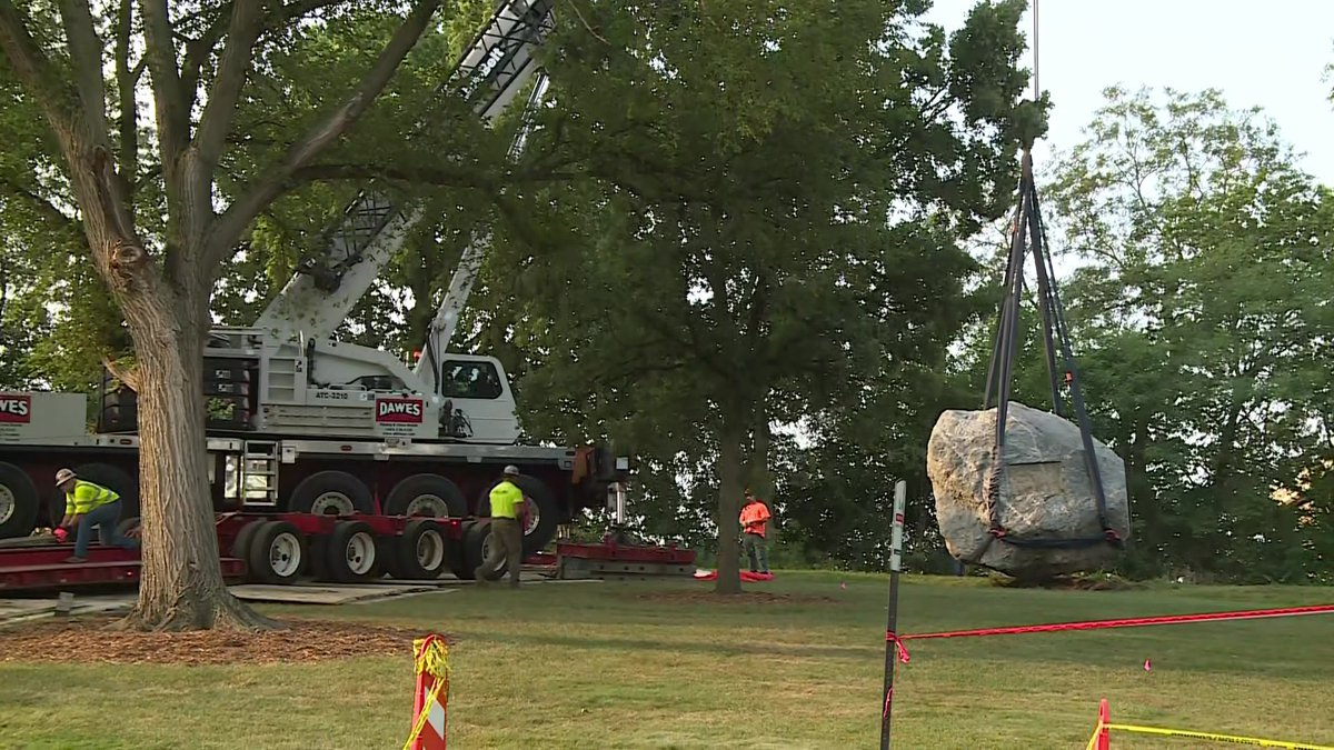 Crews remove Chamberlain Rock from the University of Wisconsin campus on Friday, August 9, 2021.