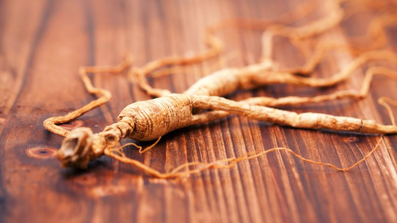 Ginseng on the wood background