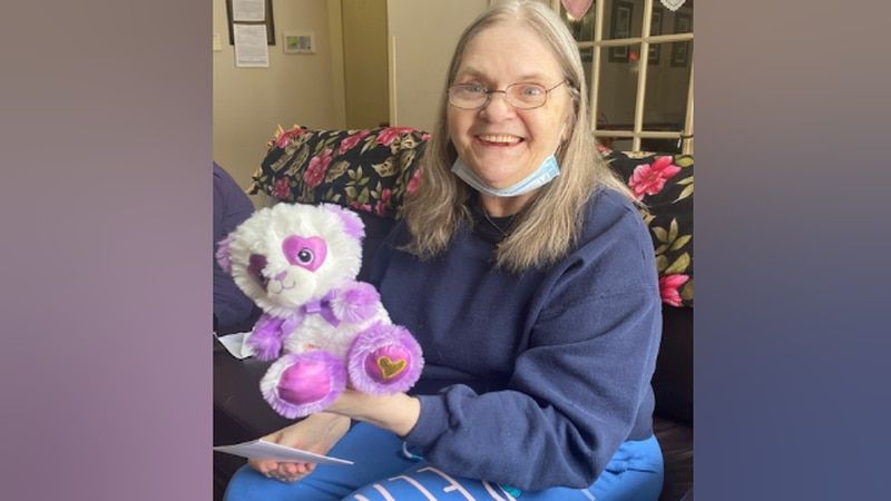 Resident Nancy poses with a Valentine's Day bear at Our House Senior Living in Janesville.
