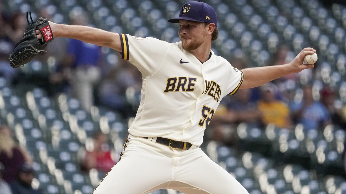 Milwaukee Brewers starting pitcher Eric Lauer throws during the first inning of a baseball game...