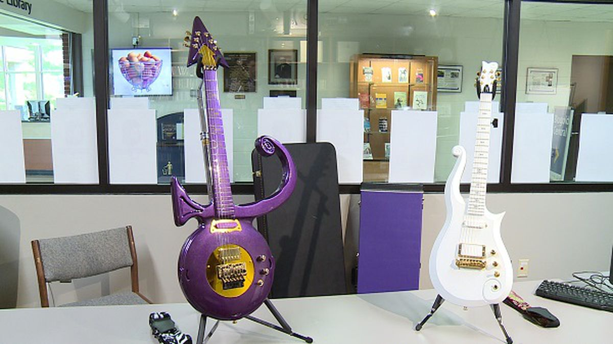 Two guitars from Prince's personal collection are displayed at Blugold Radio on the UW-Eau...