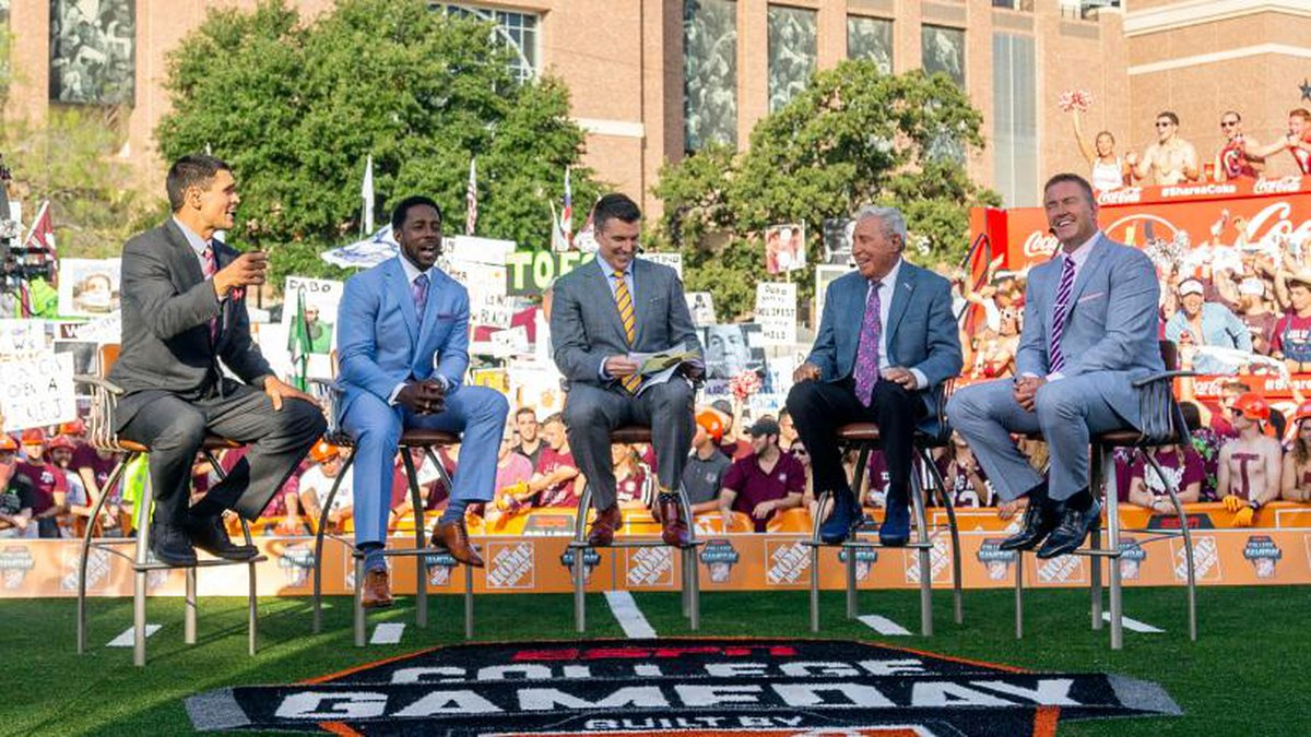 FILE - In this Sept. 8, 2018, file photo ,ESPN College Game Day's crew sits on set in front of...