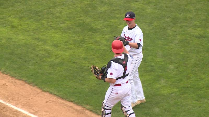 The Eau Claire Cavaliers celebrate after getting out of an inning against the Beef River...