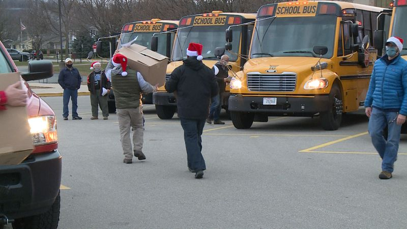 Wednesday morning, West Salem School District staff loaded buses with gifts, then went...