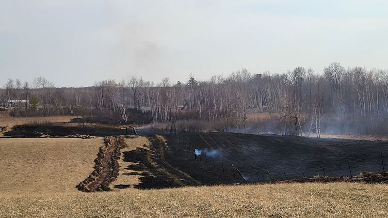 Grass fire burned more than eight acres on private property north of Jim Falls on Sunday.