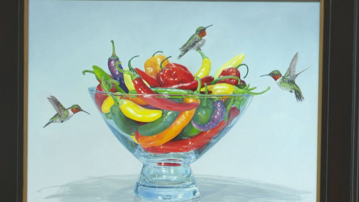 Marshfield artist Rebecca Korth is showing  a painting of chili peppers and hummingbirds