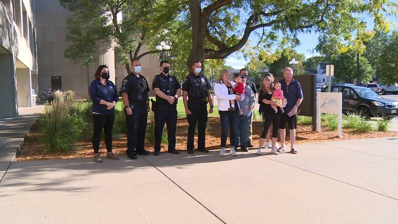 Elijah Roge, 2 reunites with the officers who helped save him when he nearly drowned in the...