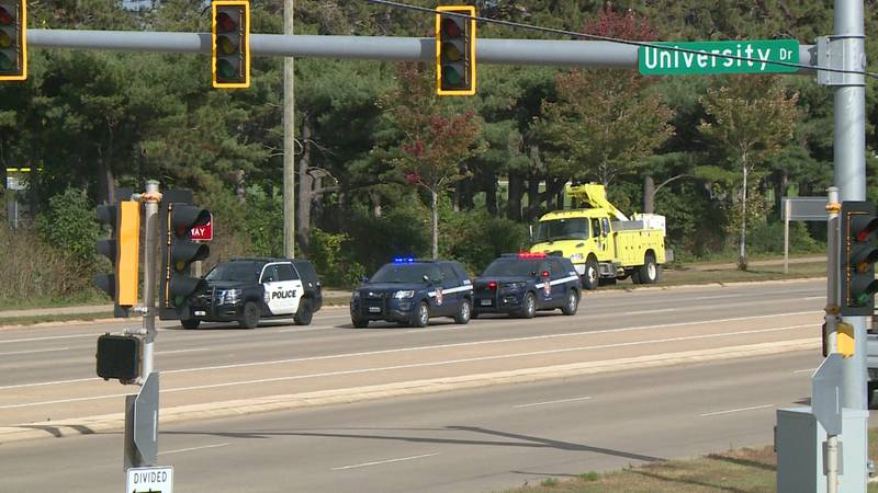 Wisconsin State Patrol and Eau Claire Police vehicles block traffic on Clairemont Avenue in Eau...