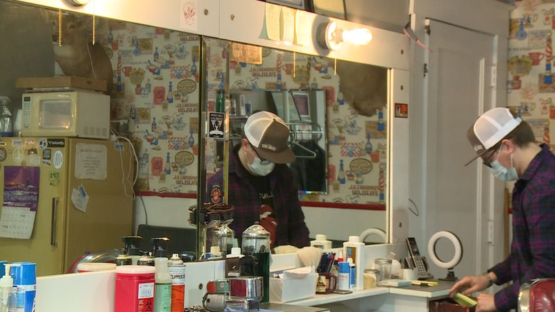 Ed's Barber Shop owner Brett Watnemoe, recently took over the business from his grandfather who...