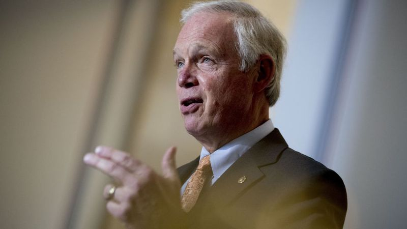 Chairman Sen. Ron Johnson, R-Wis., speaks to a reporter before the Senate Homeland Security and...