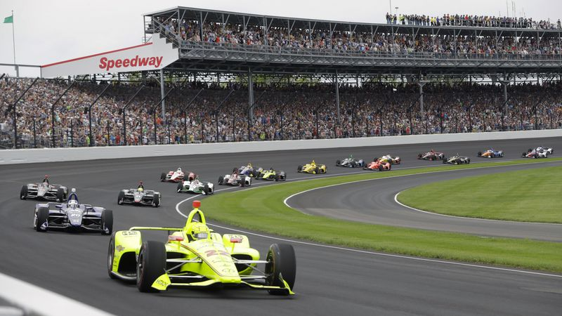 FILE - In this May 26, 2019, file photo, Simon Pagenaud, of France, leads the field through the...
