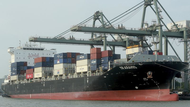FILE - In this May 3, 2020 file photo, containers are loaded on a ship at the Saigon port in Ho...