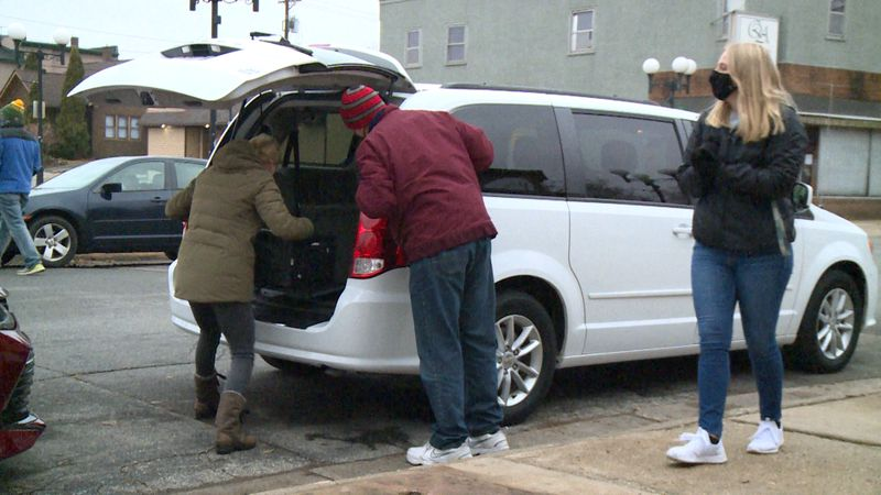 About 20 full-time staff from the Boys & Girls Club loaded up their cars at 3 p.m. and donated...