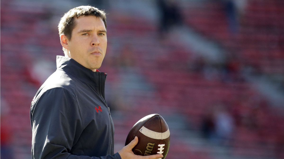 FILE - In this Sept. 9, 2017, file photo, Wisconsin defensive coordinator Jim Leonhard holds a...