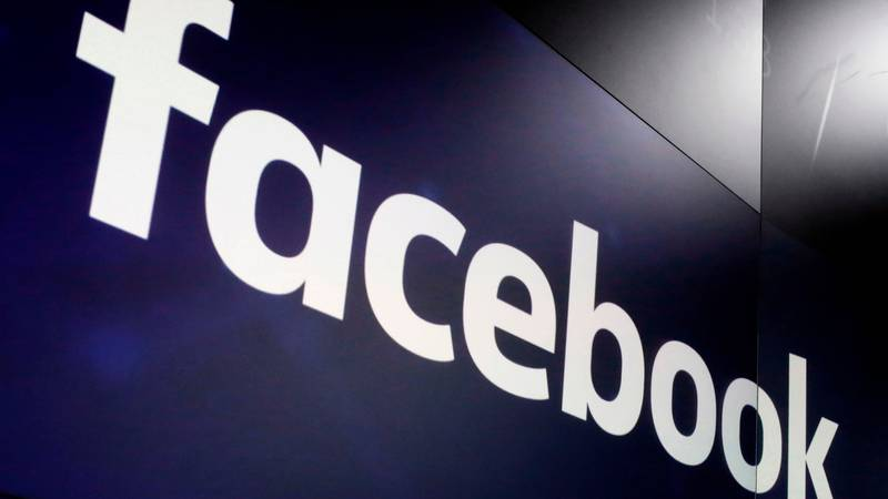 FILE - In this March 29, 2018, file photo, the logo for Facebook appears on screens at the...