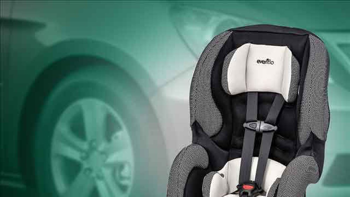 Child suffocated by car seat harness