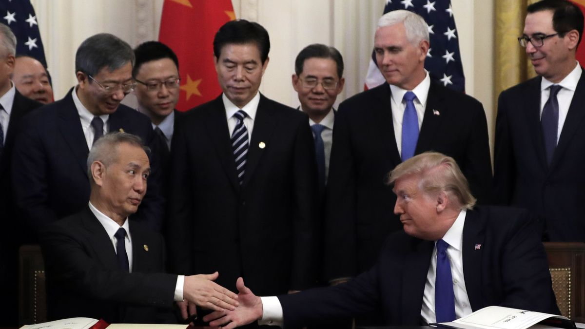 President Donald Trump shakes hands with Chinese Vice Premier Liu He, after signing a trade agreement in the East Room of the White House, Wednesday, Jan. 15, 2020, in Washington. (AP Photo/Evan Vucci)